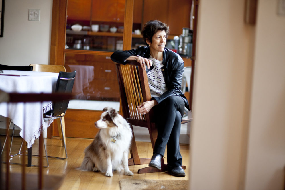 The author, a Harvard Medical School associate professor of psychiatry, pictured at her Cambridge home with dog, in 2012. She was diagnosed with cancer in August 2015. (Rose Lincoln/Harvard Staff Photographer)
