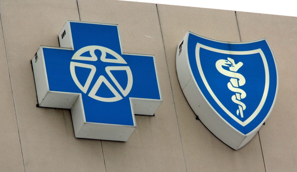 The Blue Cross Blue Shield of Michigan logos. (Carlos Osorio/AP)