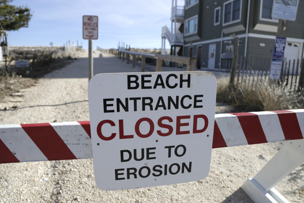 Climate change is accelerating the erosion of beaches around the world, according to a study published this week in the journal Nature Climate Change. (Julio Cortez/AP)