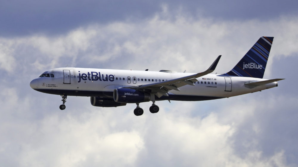 A JetBlue Airways flight flies into Salt Lake City International Airport. (Rick Bowmer/AP)