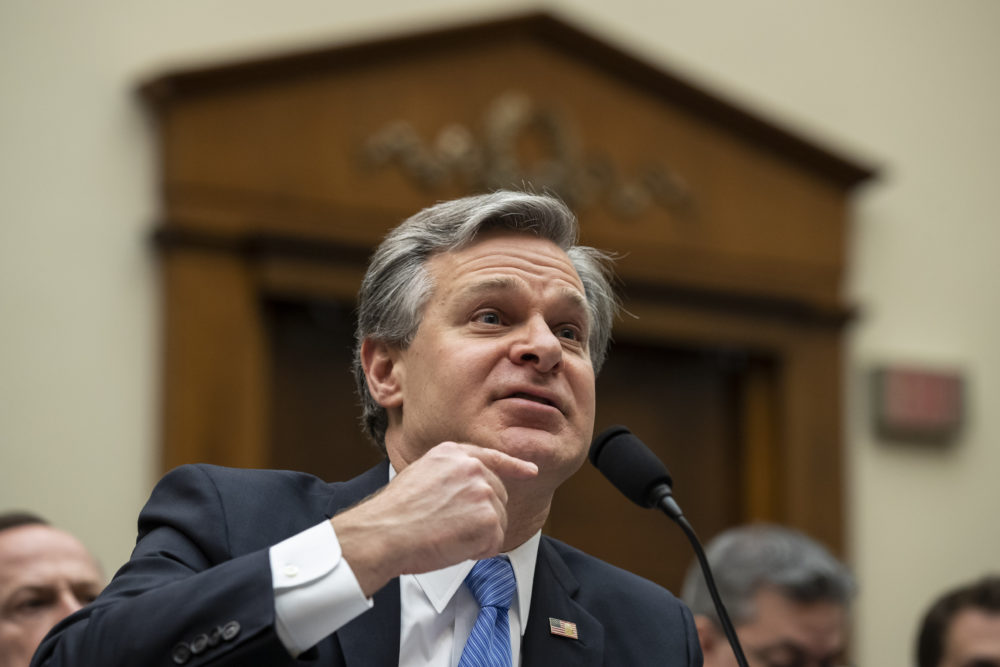 FBI Director Christopher Wray, pictured at a congressional hearing last month, spoke at Boston College Wednesday. (Alex Brandon/AP)