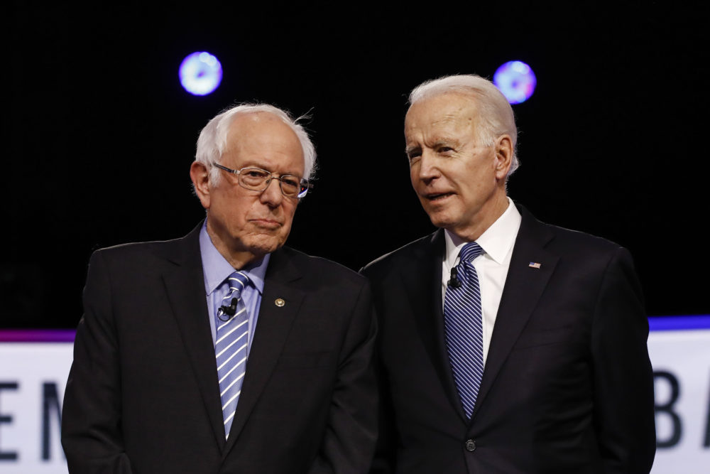 Democratic presidential candidates, Sen. Bernie Sanders, I-Vt., former Vice President Joe Biden, talk before a Democratic presidential primary debate, Tuesday, Feb. 25, 2020, in Charleston, S.C. (Matt Rourke/AP)