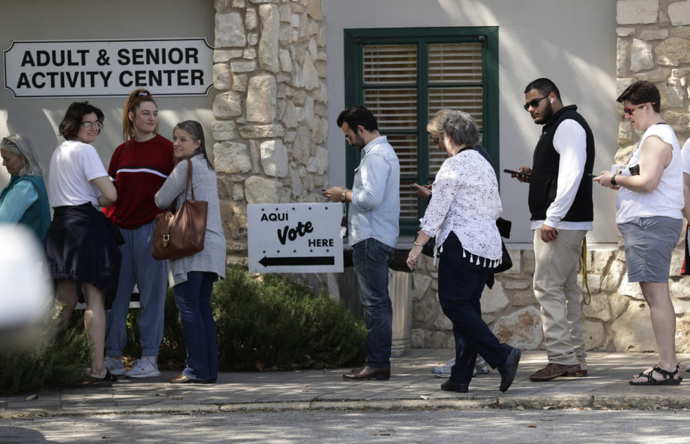 In this Friday, Feb. 28, 2020 photo, voters wait in line at an early polling site in San Antonio, Texas. (Eric Gay/AP)