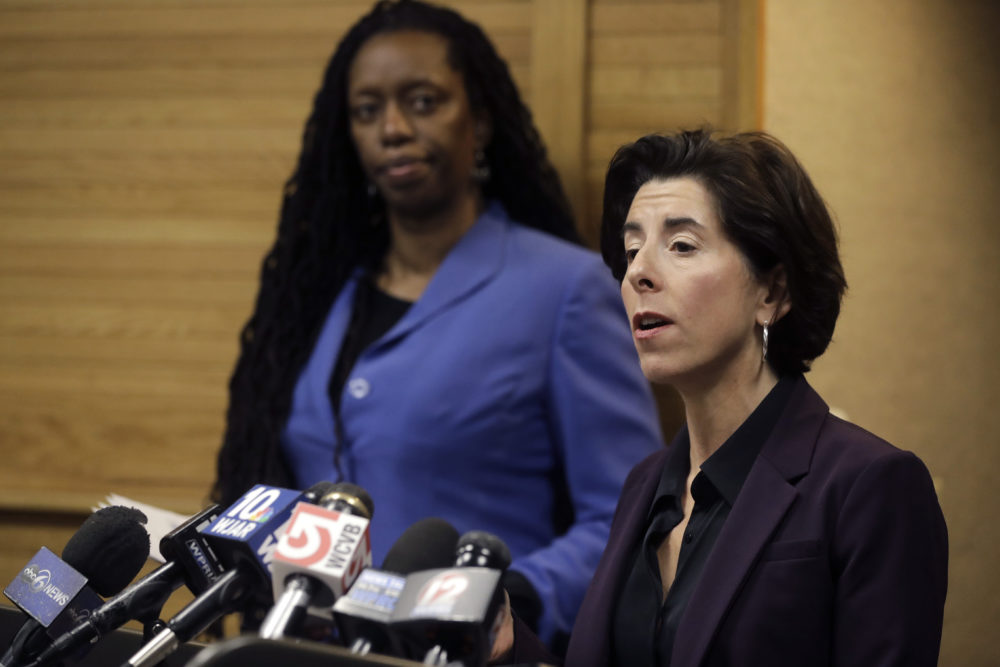 Rhode Island Gov. Gina Raimondo, right, and R.I. Director of Health Nicole Alexander-Scott, behind left, during a news conference about what officials described as the state's first presumptive positive case of  the disease caused by the novel coronavirus. (AP Photo/Steven Senne)