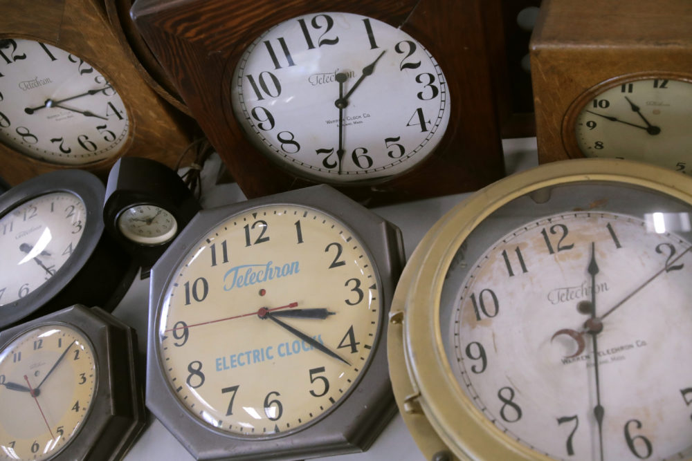 In this Thursday, March 5, 2020, photo, antique clocks are displayed at the Electric Time Company, in Medfield, Massa. Most Americans will lose an hour of sleep this weekend, but gain an hour of evening light for months ahead, as Daylight Saving Time returns this weekend. The time change officially starts Sunday at 2 a.m. local time. (Charles Krupa/AP)