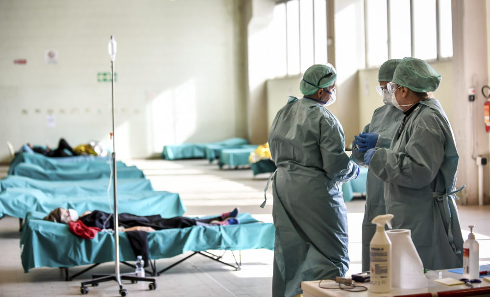 Medical personnel work inside one of the emergency structures that were set up to ease procedures at the hospital of Brescia, Northern Italy, on Tuesday. (Claudio Furlan/LaPresse via AP)