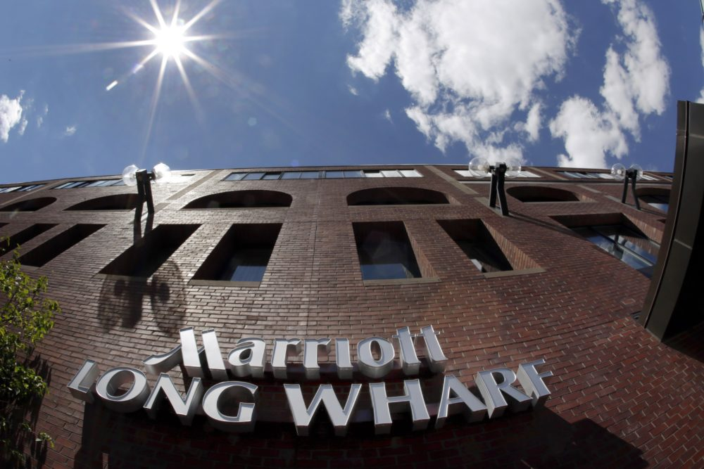 Marriott Long Wharf in Boston. Seventy of Massachusetts' first 92 confirmed coronavirus cases have been linked to a meeting of Biogen executives that was held at the hotel in late February 2020. (Elise Amendola/AP File Photo)