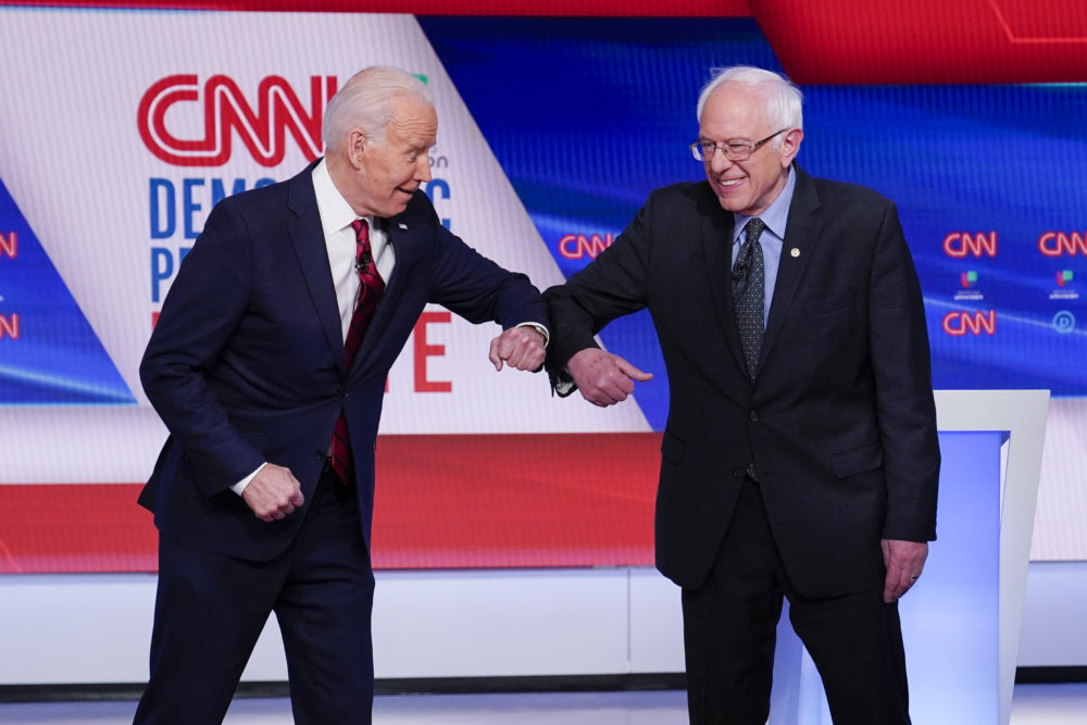 Former Vice President Joe Biden, left, and Sen. Bernie Sanders, I-Vt., right, greet one another before they participate in a Democratic presidential primary debate at CNN Studios in Washington, Sunday, March 15, 2020. (Evan Vucci/AP)