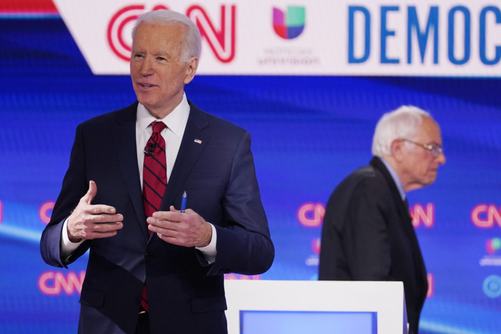 Sen. Bernie Sanders, I-Vt., right, and former Vice President Joe Biden, left, return to the stage after a commercial break in a Democratic presidential primary debate at CNN Studios, Sunday, March 15, 2020, in Washington. (Evan Vucci/AP)