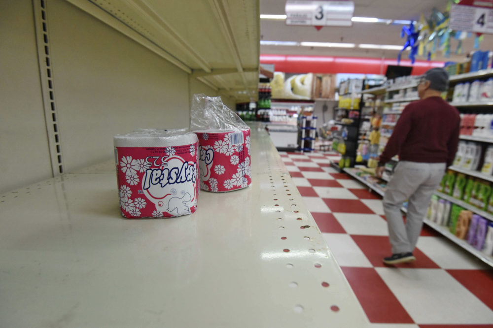A customer walks down the toilet paper aisle at La Unica Supermarket Wednesday, March 18, 2020, in Greenville, S.C. (Richard Shiro/AP)