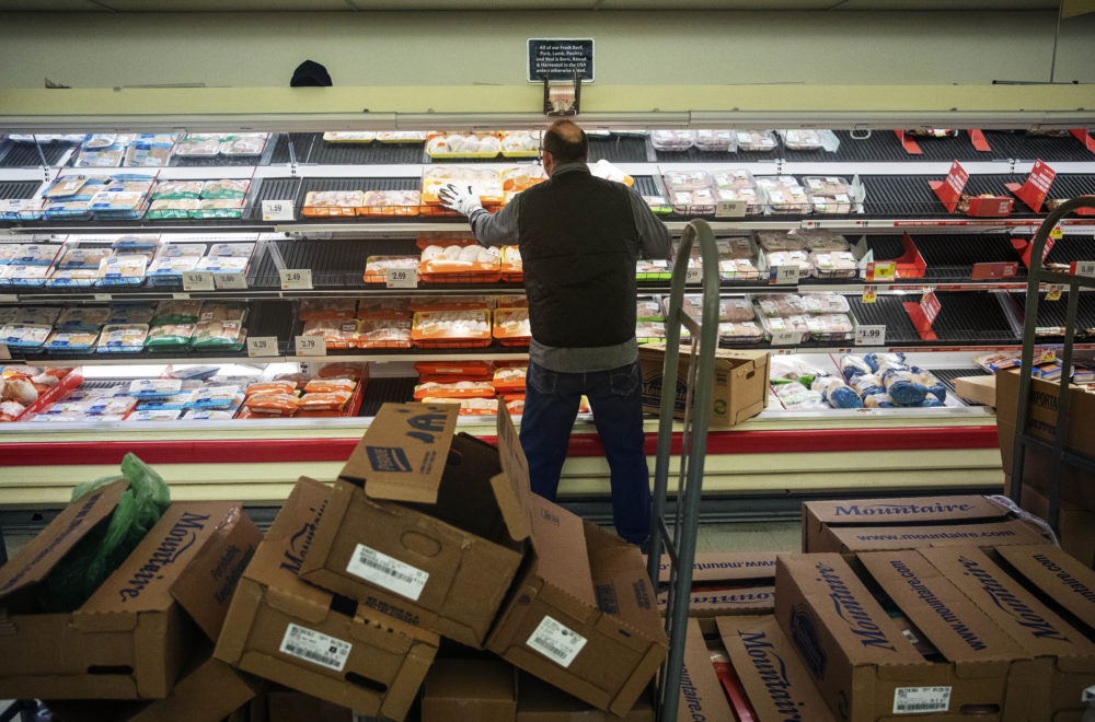 A worker restocks the meat section of a Stop & Shop supermarket during hours open daily only for seniors Thursday, March 19, 2020, in North Providence, R.I.  (David Goldman/AP)