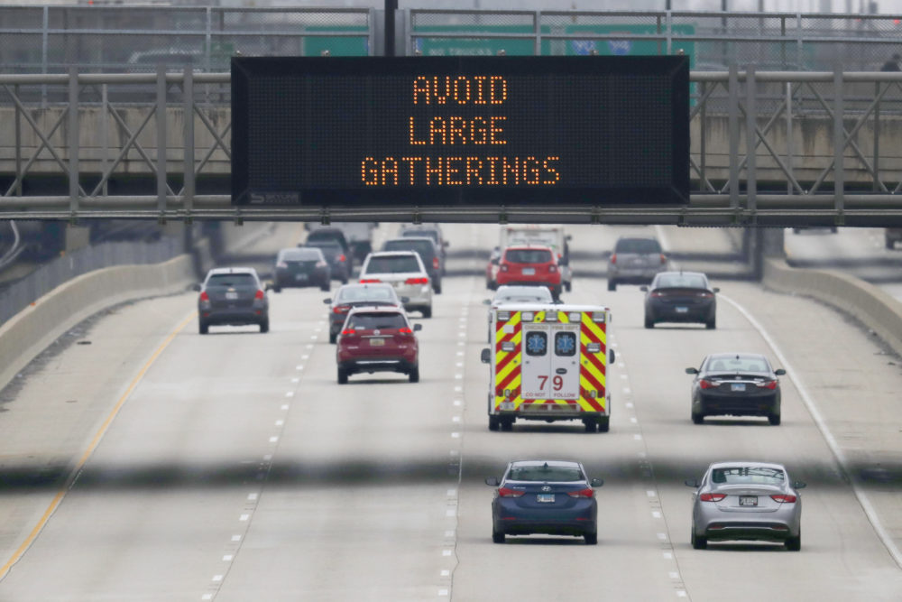 A public service announcement about coronavirus prevention is displayed on an electronic traffic message board as an ambulance travels northbound on Chicago's Dan Ryan Expressway, Thursday, March 19, 2020. (Charles Rex Arbogast/AP Photo)