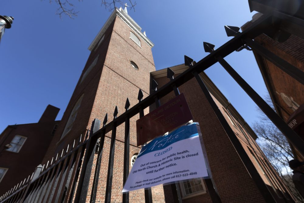 A sign announces the closure of historic Old North Church in Boston, Saturday, March 21, 2020, due to the outbreak of the COVID-19 coronavirus. (AP Photo/Michael Dwyer)