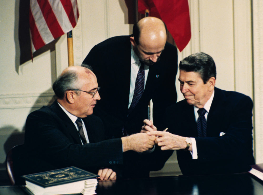 In this Dec. 8, 1987 file photo, President Ronald Reagan, right, and Soviet leader Mikhail Gorbachev exchange pens during the Intermediate Range Nuclear Forces Treaty signing ceremony in the White House. (Bob Daugherty/AP Photo)