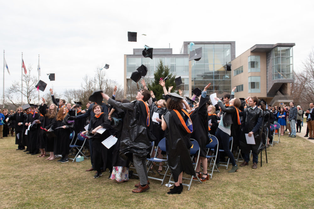 Olin College graduates throw their caps in their air at a faux-Commencement ceremony. (Leise Jones)