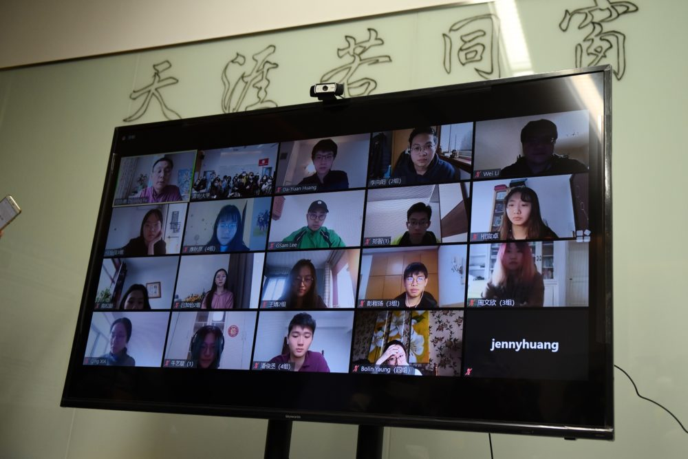 Students are seen on a screen during an online class taken by teacher Fu Zhiyong (top L) at the Academy of Arts and Design at Tsinghua University during a government-organised tour in Beijing on February 28, 2020. (GREG BAKER/AFP via Getty Images)