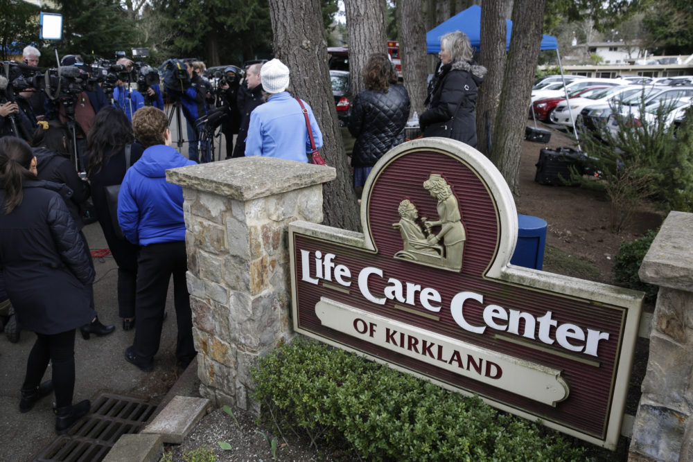 Family members of residents of the Life Care Center nursing home, where some patients have died from COVID-19, hold a press conference outside the center in Kirkland, Washington on March 5. (Jason Redmond/AFP via Getty Images)