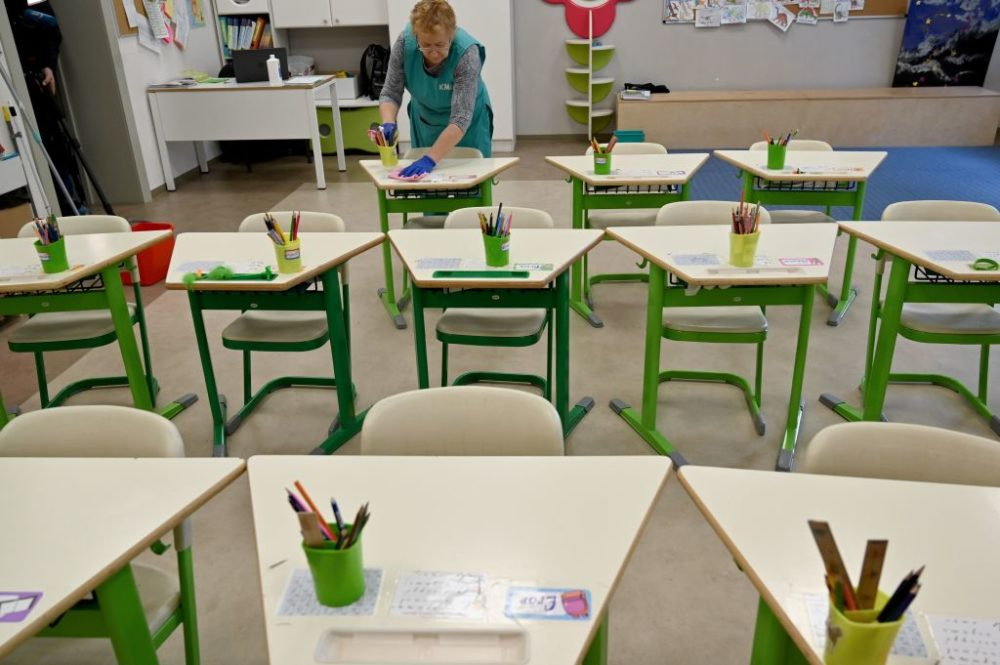 An employee disinfects a classroom of a school. (Sergei Supinsky/AFP/Getty Images)