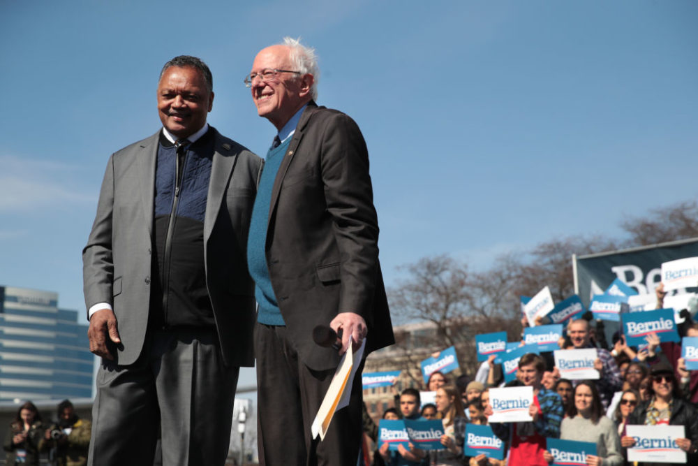 Sen. Bernie Sanders and Rev. Jesse Jackson greet the crowd during a campaign rally in Grand Rapids, Michigan. (Scott Olson/Getty Images)