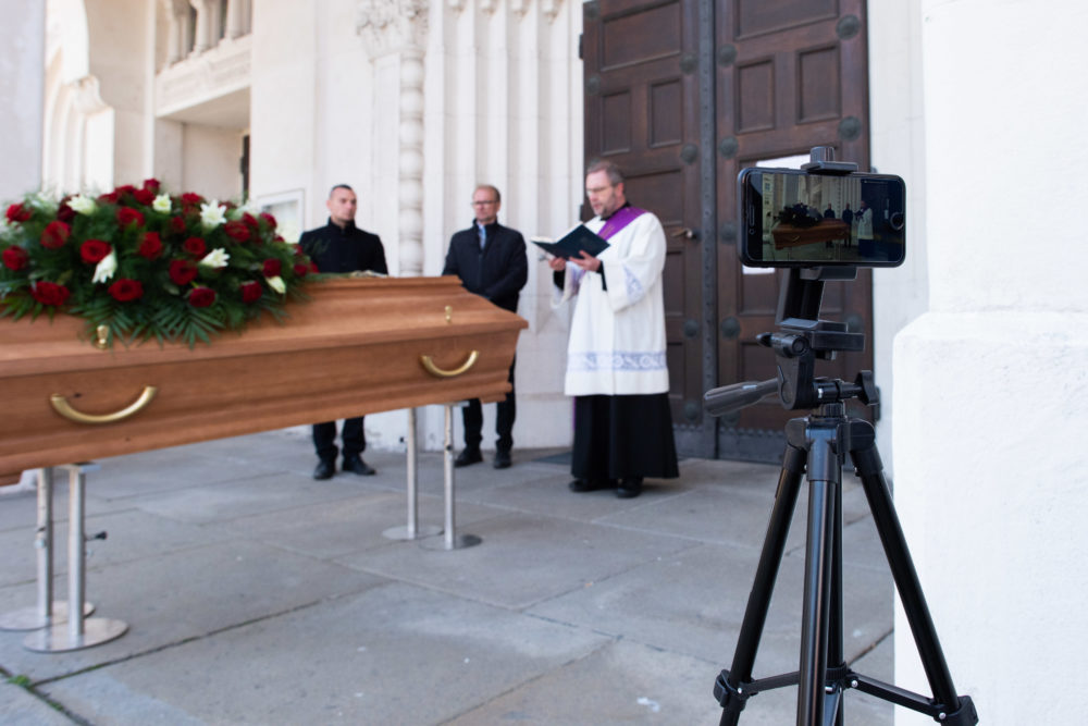 Deacon Otmar Gindl and employees of Bestattung Himmelblau undertakers rehearse the livestreaming of an upcoming funeral on March 24, 2020 in Vienna, Austria. (Thomas Kronsteiner/Getty Images)