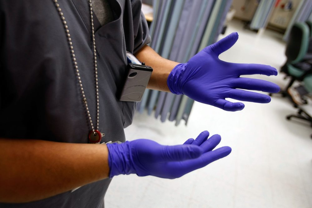 One of the first things health care workers learn is the proper way to put on, wear and dispose of Proper Protective Equipment gloves. (Joe Raedle/Getty Images)