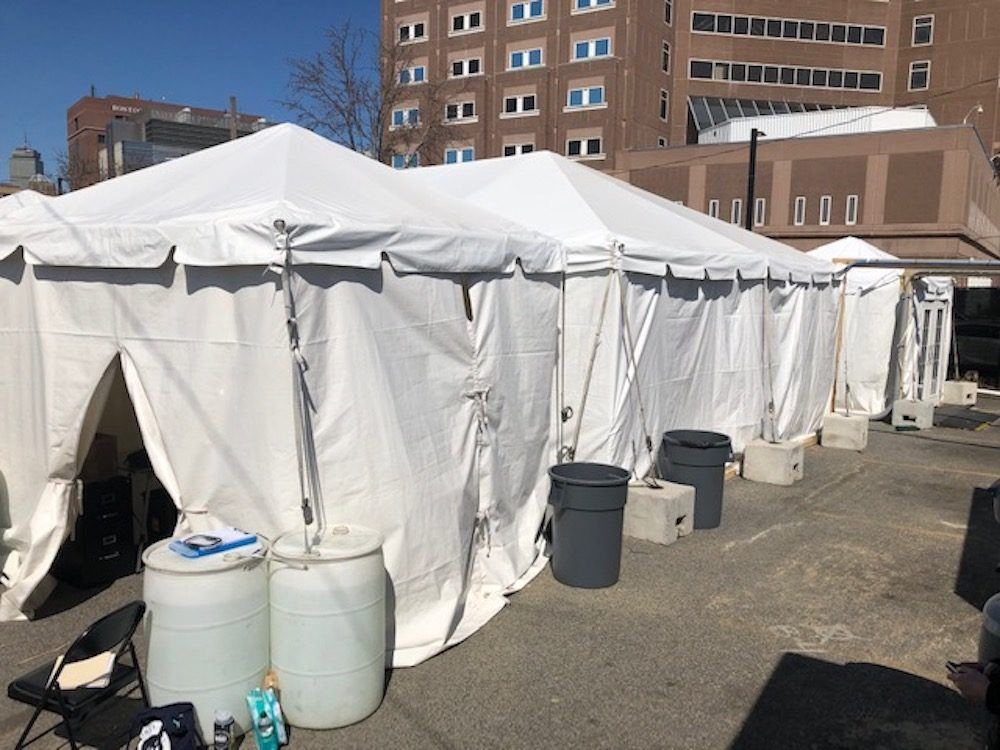 Boston Health Care for the Homeless Program set up tents to quarantine and isolate people who may have COVID-19. (Martha Bebinger/WBUR)