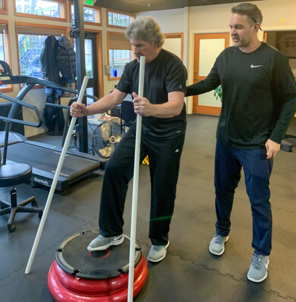 Randy Devitt working out with Nate Coomer. (Cloe Axelson/WBUR)