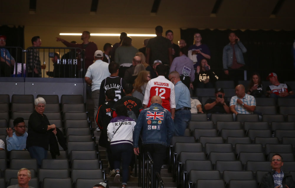 NBA fans leave the arena on Wednesday night after the Sacramento Kings game against the New Orleans Pelicans was postponed due to the coronavirus. The NBA season has been suspended. (Ezra Shaw/Getty Images)