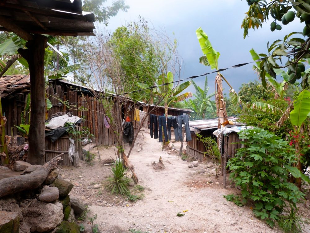 In rural Honduras up to 10 people may live in homes such as this one outside La Florida. Running water, indoor bathrooms are rare, and family members often share beds, making distancing almost impossible. (Karyn Miller-Medzon/Here & Now)