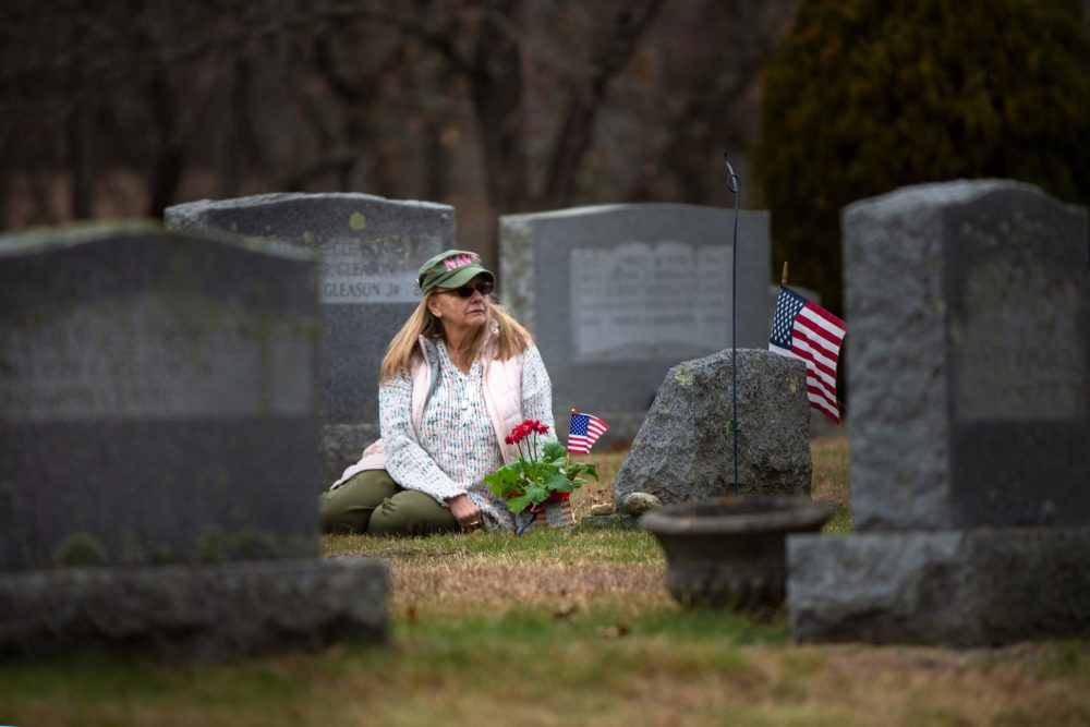 Susan Chamberlain visits the grave of her late husband, Kevin Chamberlain, in Andover. (Jesse Costa/WBUR)