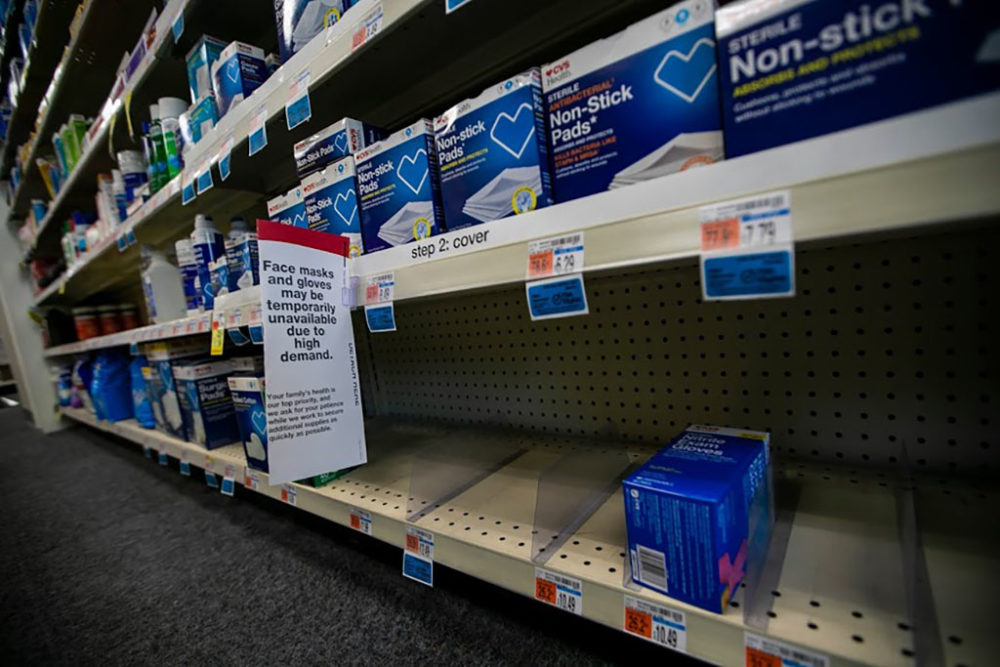 Shelves at the CVS Pharmacy on Commonwealth Ave. are temporarily empty of face masks and gloves. (Jesse Costa/WBUR)