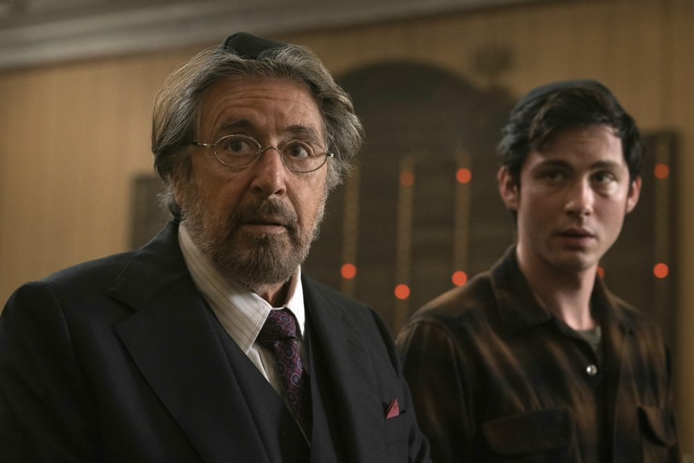 "This image released by Amazon Studios shows Al Pacino, left, and Logan Lerman in a scene from ""Hunters."" (Christopher Saunders/Amazon Studios)"