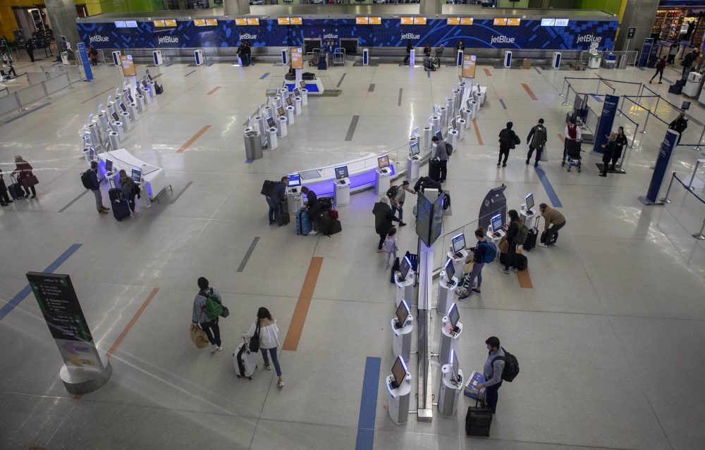 In this file photo, light passenger traffic through the jetBlue check-in area at Logan Airport. (Robin Lubbock/WBUR)