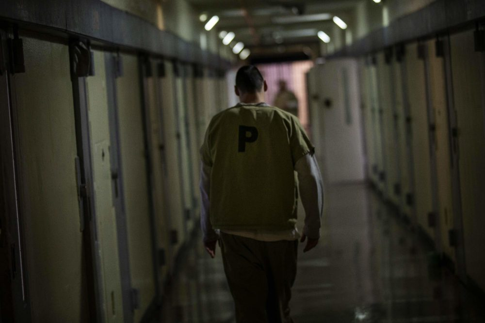 An inmate walks down one of the hallways of Worcester County jail. (Jesse Costa/WBUR)