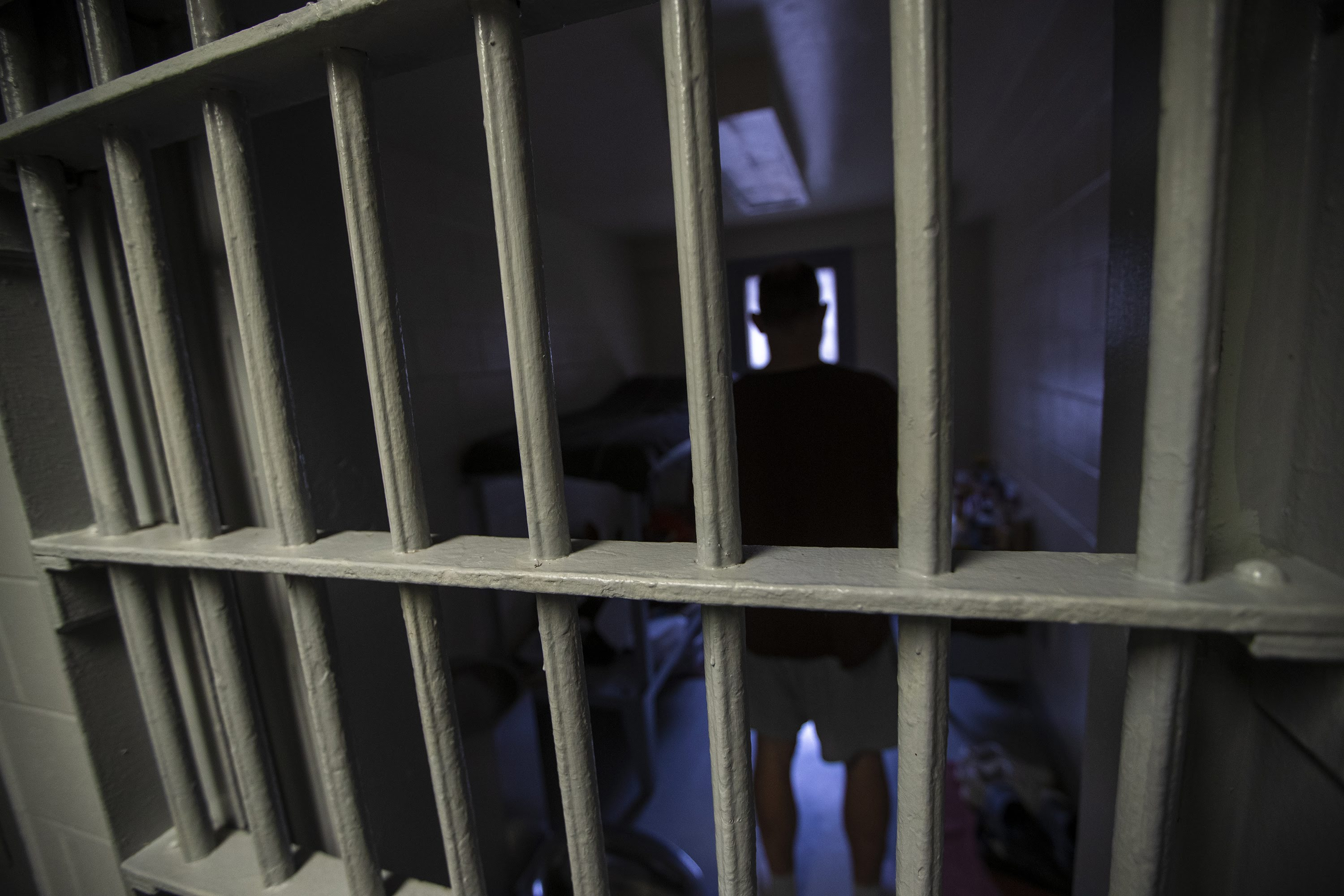 An inmates stands in a cell inside one of Massachusetts' county jails. (Jesse Costa/WBUR)
