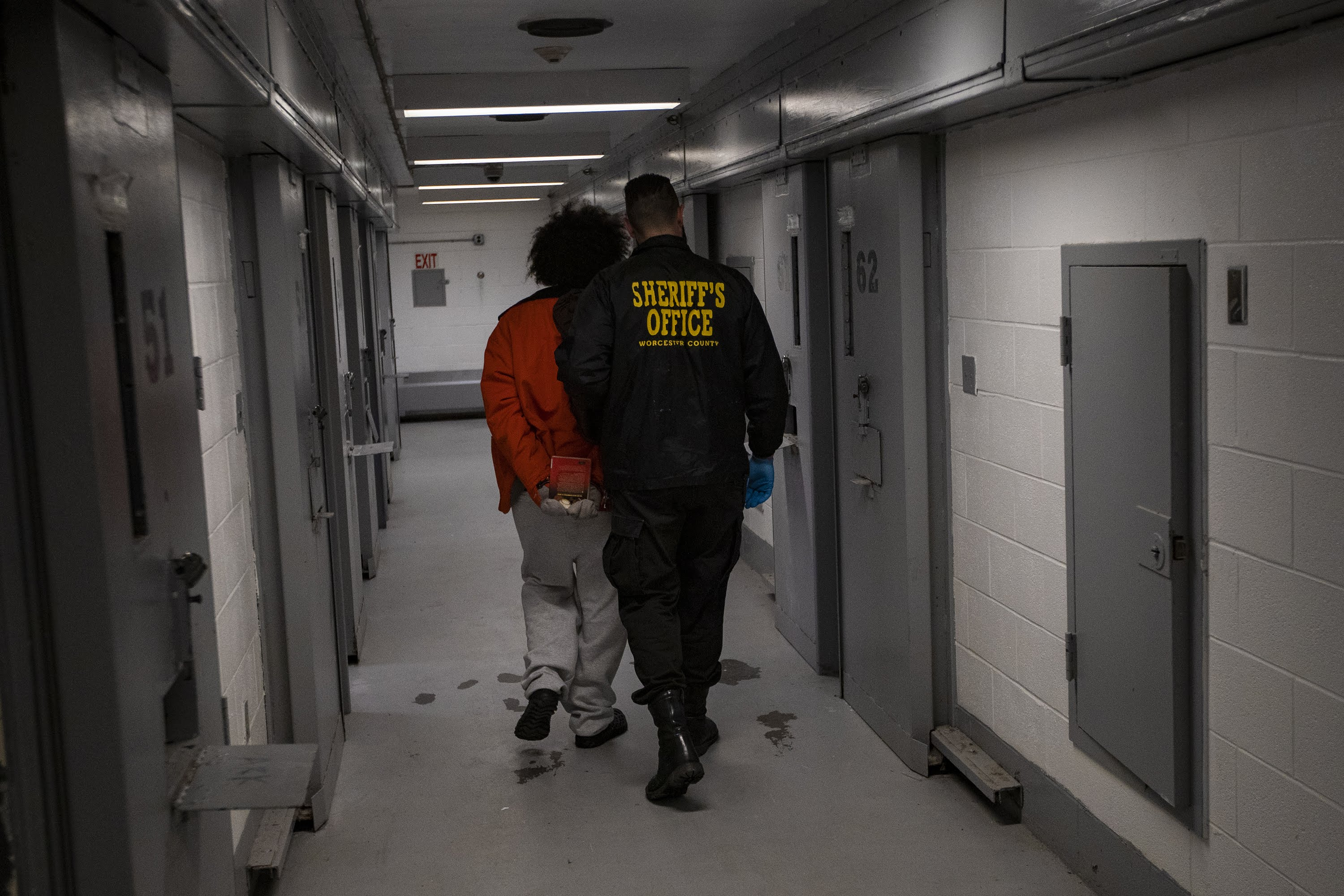 An inmate walks down a hallway inside the Worcester County jail. (Jesse Costa/WBUR)