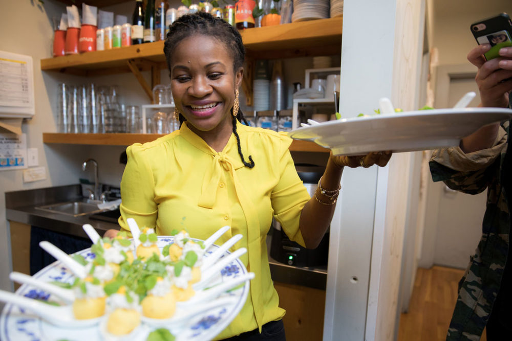 Chef Tamika Francis serves up dinner at her Food & Folklore Peruvian pop-up dinner. (Courtesy Kay Joplin Photography)