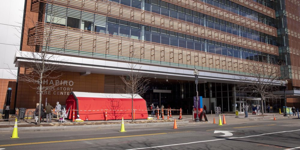 A red tent for testing some patients for coronavirus by appointment near one of the entrances outside the Shapiro Ambulatory Care Center at Boston Medical Center on March 16. (Robin Lubbock/WBUR)
