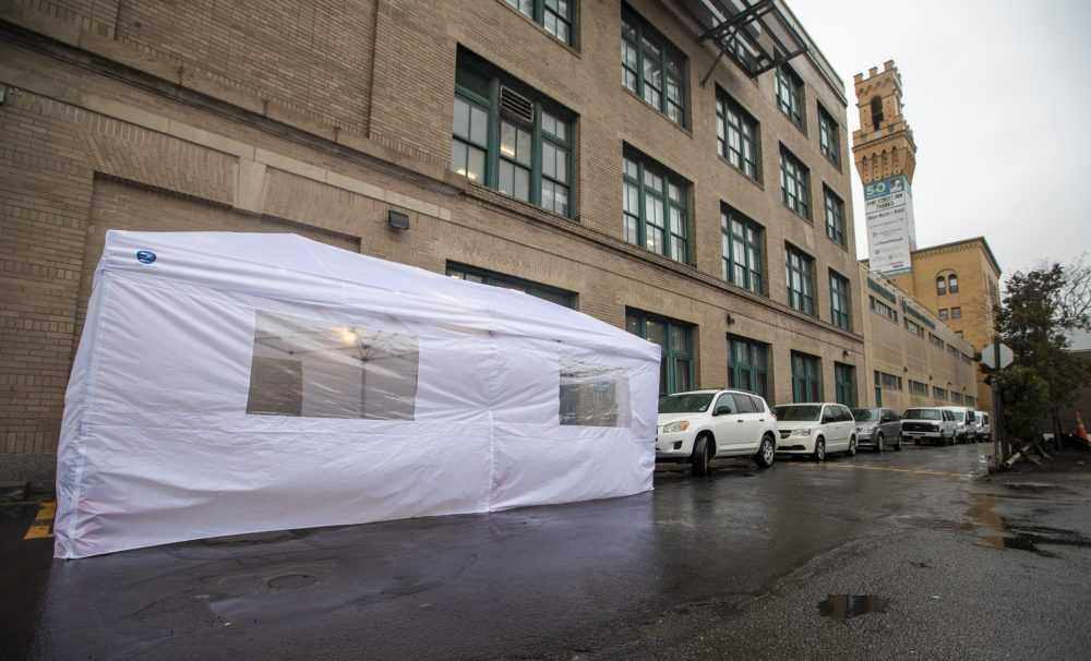 Pine Street Inn put up a coronavirus testing tent for people who are homeless on Albany St. in Boston. (Jesse Costa/WBUR)