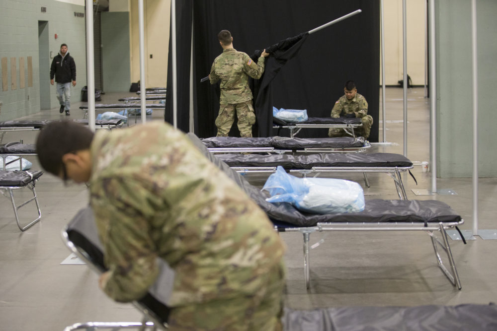 Members of the Massachusetts National Guard erect a medical field hospital at the DCU Center in Worcester for the expected influx of patients due to the COVID-19 pandemic. (Nicolaus Czarnecki/MediaNews Group/Boston Herald)