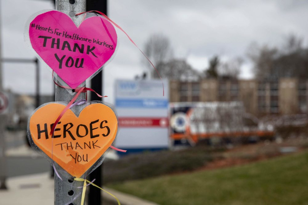 """A message left on a street signpost by the Melrose Wakefield Hospital with the hashtag #HeartsForHealthcareWorkers, says """"Thank you."""" (Robin Lubbock/WBUR)"""