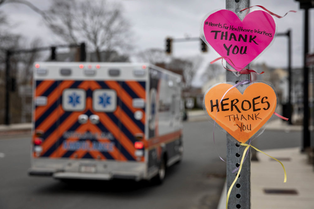 "A message left on a street signpost by the Melrose Wakefield Hospital with the hashtag #HeartsForHealthcareWorkers, says ""Thank you."" (Robin Lubbock/WBUR)"