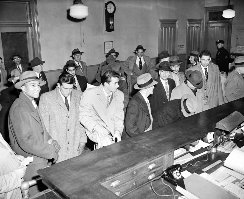 Just a year after winning the 1950 NIT and the NCAA Tournament, City College players were arrested for their involvement in a point shaving scandal. (AP)