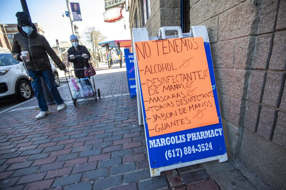 A sign at Margolis Pharmacy in Chelsea indicating, in Spanish, they do not have many of the items necessary for people to combat the COVID-19 pandemic, April 7, 2020. (Jesse Costa/WBUR)