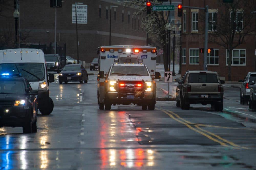 A Boston EMS ambulance races down Albany Street towards Boston Medical Center. (Jesse Costa/WBUR)