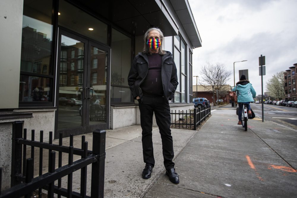 Rob Quinn standing outside of his apartment building in Boston. (Jesse Costa/WBUR)
