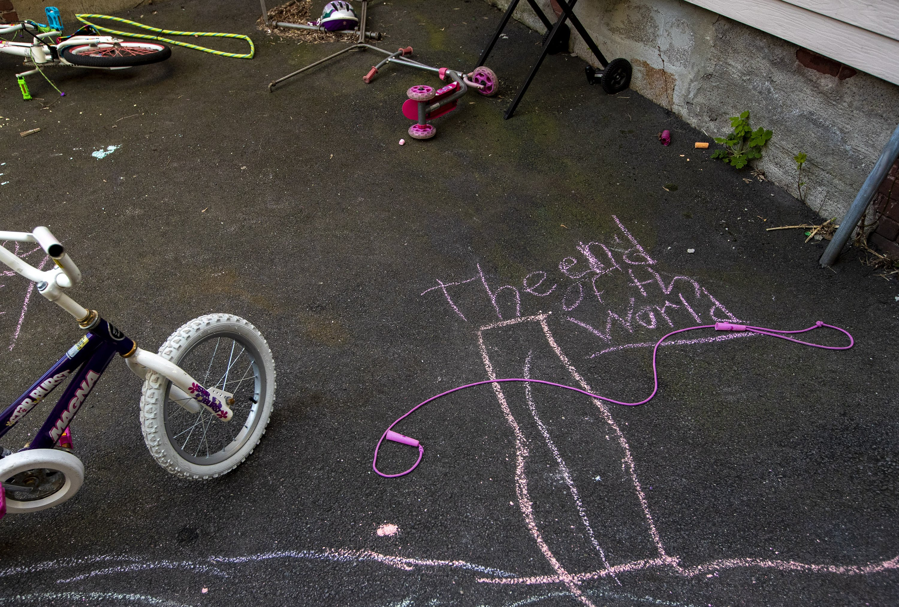 A children's chalk drawing in the backyard of a Somerville apartment house. (Jesse Costa/WBUR)