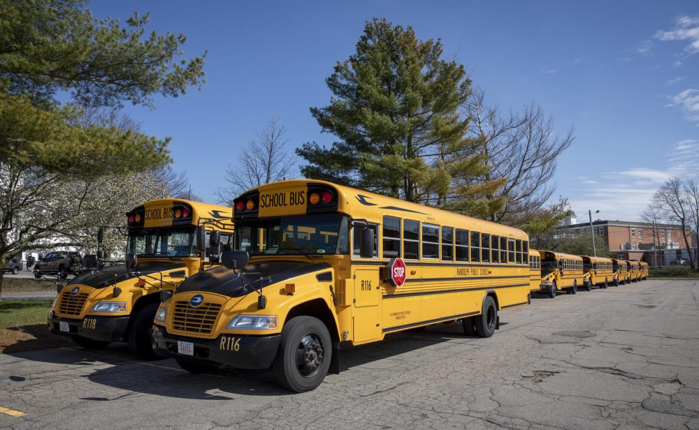 Randolph High School buses parked behind the school while the school is closed due to the COVID-19 epidemic. (Robin Lubbock/WBUR)