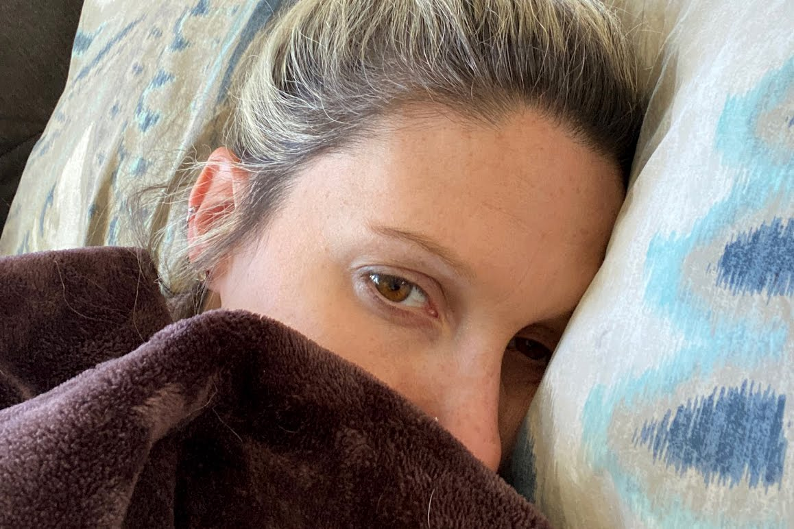 Amanda Joyce with a blanket pulled up over her nose. (Courtesy)