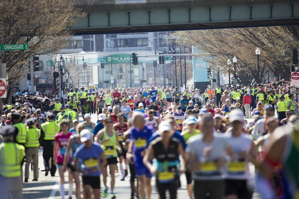 Hundreds of runners pour through Kenmore Square at the 2016 Boston Marathon. (Jesse Costa/WBUR)